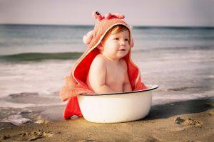 Met de baby op strandvakantie